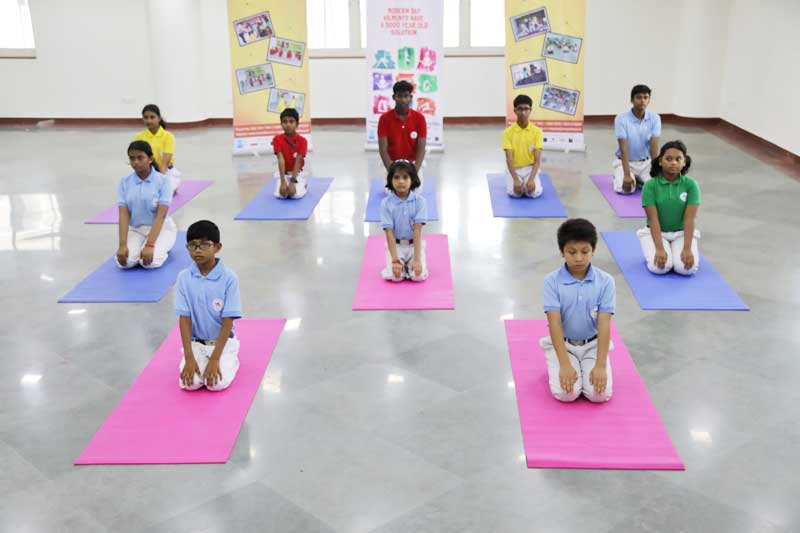 Students attending Yoga classes